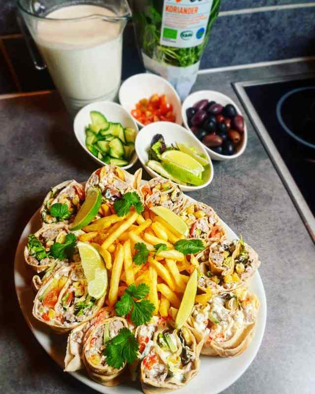 Savory Chicken kebab with lemon zest wrapped in flatbread & french fries